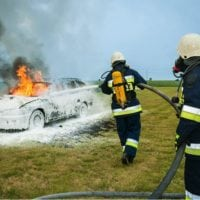 firemen-putting-out-car-fire